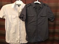 two black and white button-up t-shirts