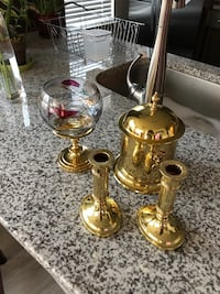 Two brass-colored candle holders Charlotte, 28277