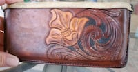 Hand carved leather case The Colony