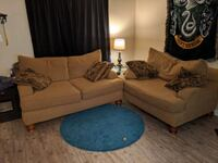 2 love seat couches. Pillows included.
