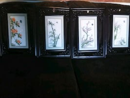 Asian theme handsewn wall decor & wooden picture frames.
