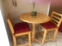 round brown wooden table with four chairs dining set Doral, 33166