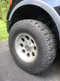 Gray bullet hole car wheel with tire set null