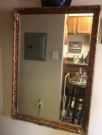 brown wooden framed wall mirror