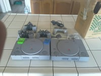 two gray Nintendo game consoles with controllers Ukiah, 95482