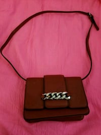 Red and black crossbody bag.