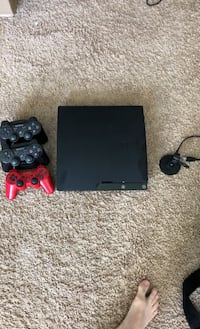 PS3 and 3 game controllers charging dock and a headpiece  Detroit, 48207