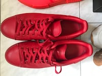 Pair of red adidas low-top sneakers Montréal, H1S
