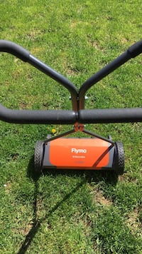 black and orange Flymo reel lawnmower Hamilton, L8K 2J2