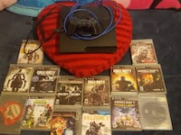 Sony PS3 console with controller and game cases