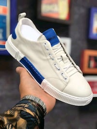 unpaired white and blue Adidas low top sneaker Washington, 20003