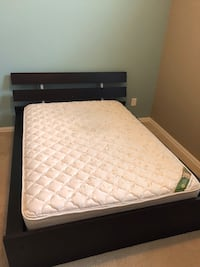 black wooden bed frame with white mattress College Station, 77840