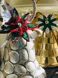 two silver-colored and gold-colored decorative Christmas bells