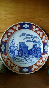 round white and blue ceramic decorative plate