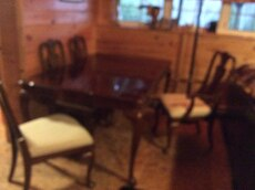 5-pc rectangular brown wooden table and padded chairs