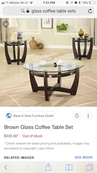 round glass top coffee table with brown wooden base Columbus, 43207