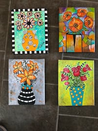 four assorted color floral wall decors 2348 mi