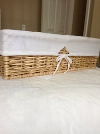 Lined wicker basket with white cotton cover