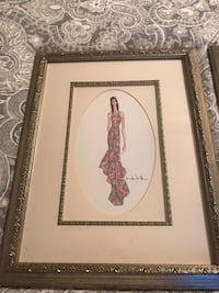 Woman in multicolored dress painting with brown wooden frame 302 mi