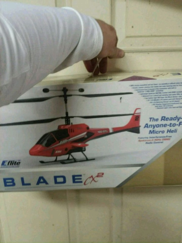 white and red helicopter toy box