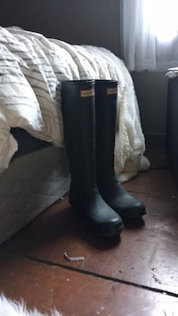 pair of black Hunter tall boots