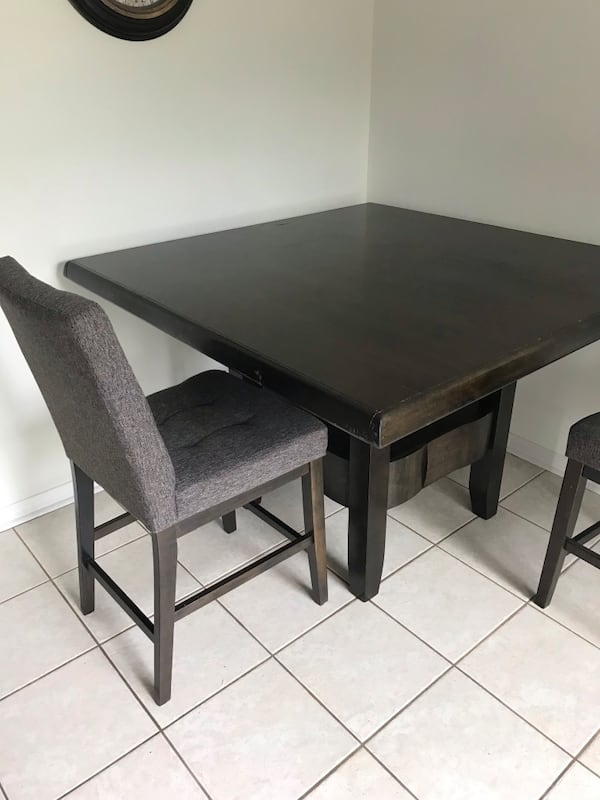 Ashley bar height dining table and 4 chairs  1f8daa2a-b228-4526-827f-3fe2d3d81b78