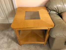 brown wooden glass top side table