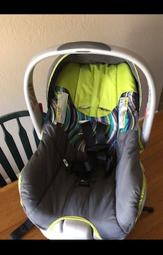 Gray and green car seat carrier
