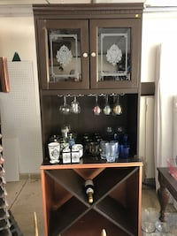 brown wooden framed glass display cabinet Albuquerque, 87109