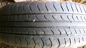 FOR SALE: 4 SUMMER TIRES ON ALUMINUM RIMS