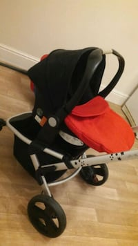 baby's black and red stroller 5773 km