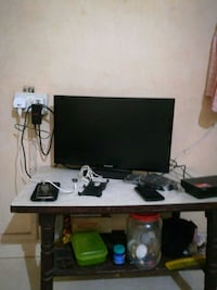 black flat screen TV; white wooden TV stand Mumbai, 400061