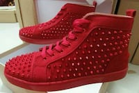 pair of red high-top sneakers