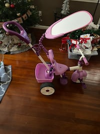 Little girls first tricycle