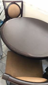 4  heavy duty comfortable  chairs and round  table- used