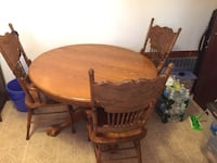 Round brown wooden table with three chairs dining set Carlstadt, 07072