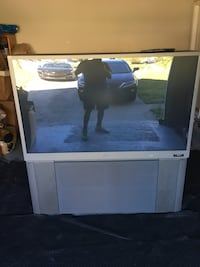 white wooden TV stand with flat screen television Lithonia, 30058
