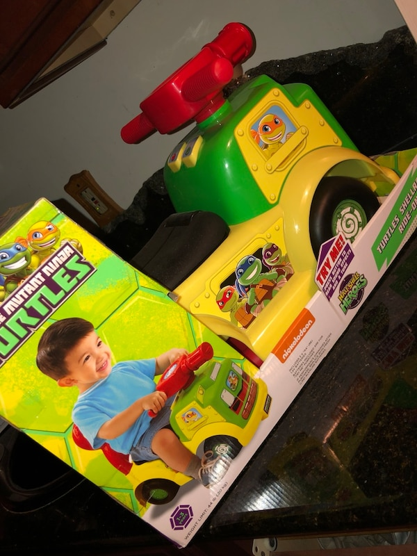 Green and yellow ninja turtles ride on toy car
