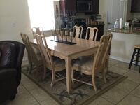 Dinning room table with 8 chairs and 2 leaves. San Antonio, 33576