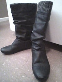 pair of black leather knee-high boots Lloydminster, T9V 0H2