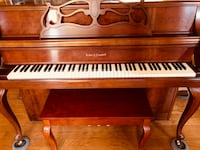 Brown wooden upright piano Tontitown, 72762