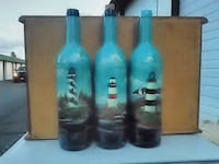 three teal-and-black bottles Yakima