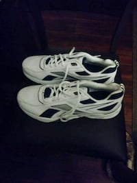 pair of white-and-black Nike running shoes Baltimore, 21214