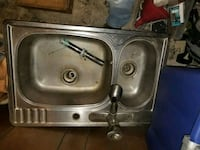 Stainless steel sink with sprayer
