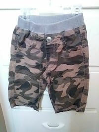 gray and black camouflage shorts