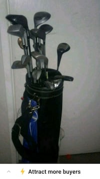 black and blue golf bag and clubs  Calgary, T2W 3N6