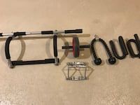 gray metal doorway pull-up bar, black Ab roller, triceps rope, and pair of black push-up bars Laval, H7W 4H5
