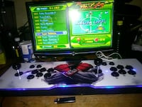 black Sony PS3 slim console with controller and game cases 574 mi
