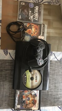 black Sony PS3 game console with controller Hyattsville, 20782