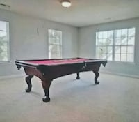 brown and red billiard table